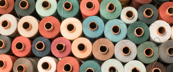Threads in a tailor textile fabric: colorful cotton threads, birds eye perspective