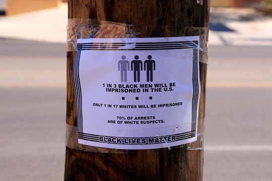 "Poster attached to a power pole supporting ""Black Lives Matter"""
