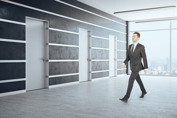 Fotomurales - Businessman walking in office hall