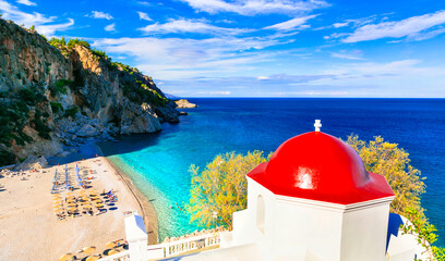 most beautiful beaches of Greece, Karpathos island - Kyra Panagia with turquoise sea and red church.