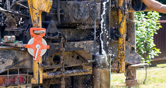 Drilling rig, drill pipe lifting. A fountain of water pours out of the pipes. Strength and energy