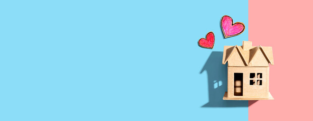 Cardboard house with heart crayon drawings - flatlay