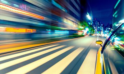 Motion blurred drive through Tokyo, Japan at night Fotomurales