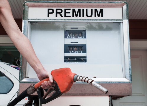 Woman pumps premium quality gas for her car