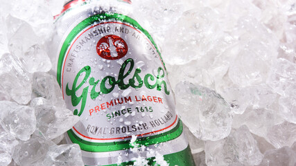 Can of Grolsch beer in crushed ice