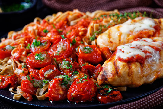 Baked cherry tomatoes topped with garlic sauce