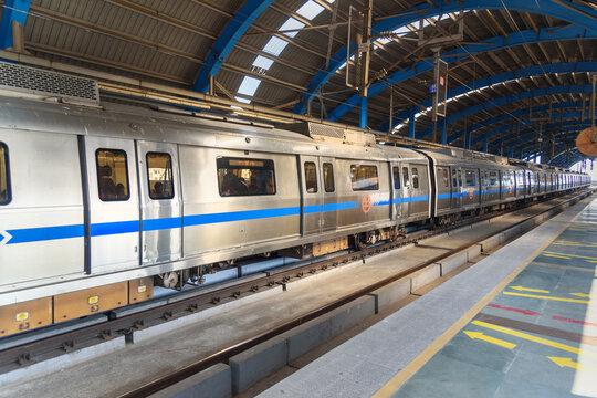 Delhi metro train stopped at metro station in New Delhi. India