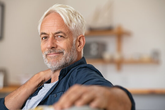 Portrait of retired satisfied man at home