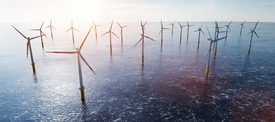 Offshore wind turbines farm on the ocean. Sustainable energy