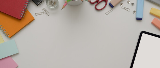Copy space on white office desk with digital device, stationery and office supplies