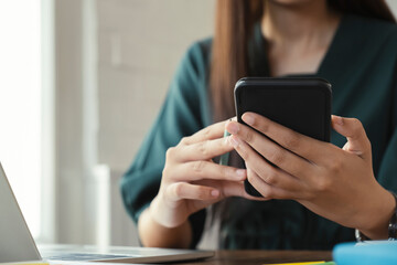 Close up of woman using mobile phone.