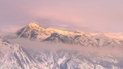 Poster Light pink Panorama frame Snowy Wasatch Mountain and hill top towering over Utah Valley under cloudy sky