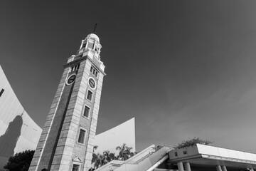 Fototapete - Historical landmark clock tower in Tsim Sha Tsui district, Hong Kong city