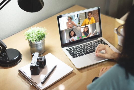 Multi ethnic Diversity Women make video call for business on laptop
