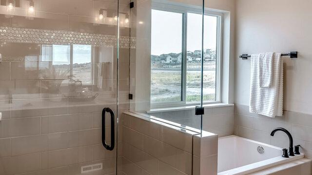 Panorama frame Frameless walk in shower stall and built in bathtub inside tile wall bathroom