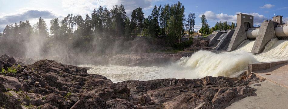 The Imatra Rapids (Imatrankoski) on the Vuoksa River in Imatra. Spillway on hydroelectric power station dam musical show. National landscape of Finland