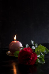 Still life with rose and candle