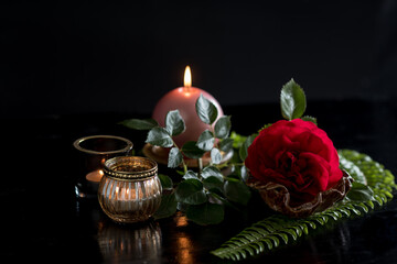 Still life with rose and candle: dark and mood