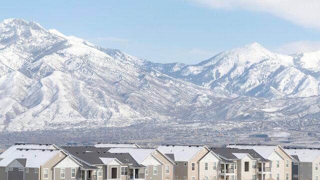 Panorama frame Neighborhood in South Jordan City 2Utah overlooking Wasatch Mountains in winter