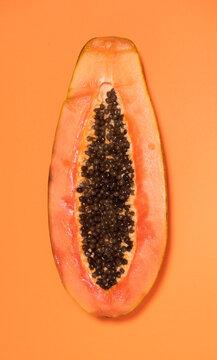 Half papaya with a plain background