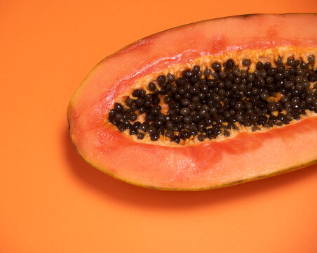 Orange background with the detail of a papaya