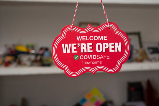 Welcome we are open sign in front of a shop after covid-19 pandemic