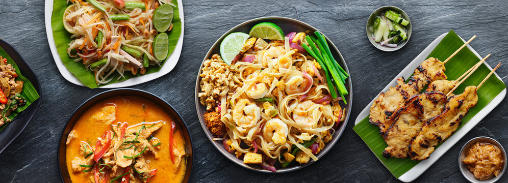 assorted thai food with shrimp pad thai and panang curry
