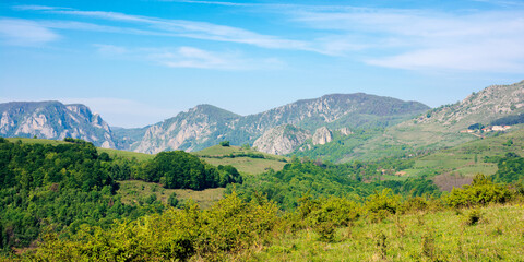 Wall Mural - rocks and cliff of romania gorges. beautiful mountain landscape view. scenic nature of apuseni natural park. rural fields on the nearest hills. sunny day.