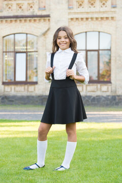 Be well. vintage kid fashion. small student girl relax on green grass. back to school. little girl looking smart and intelligent. happy schoolgirl in stylish uniform. childhood happiness