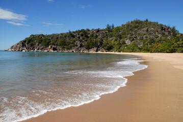 Beautiful palm fringed tropical beach at Radical Bay, Magnetic Island. Queensland, Australia