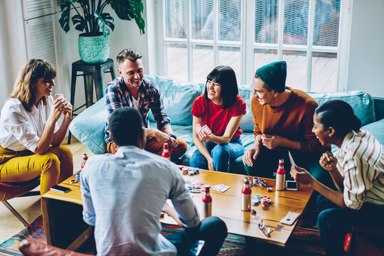 Friends spending free time together in flat