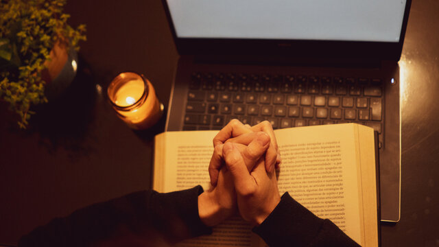 Mass online. prayer online. prays in front of a computer.