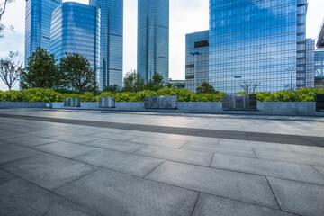 Fotomurales - empty square and city skyline under blue sky, suzhou city, china.