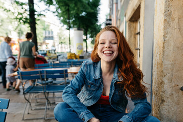 Cute young redhead woman with happy grin