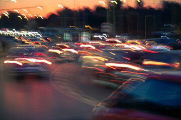Fotomurales - Traffic jam, colorful city and cars lights, blurred by speed and motion. A streak of light, trails.