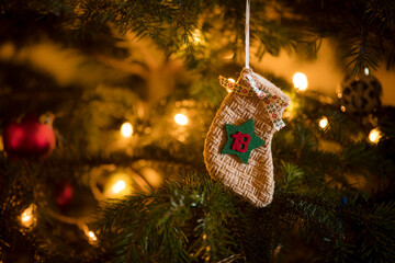 Traditional Advent Calendar Stocking with the date of the 18th of December hanging on a traditional christmas tree. Wall mural