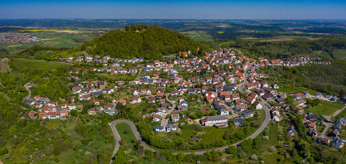 Aerial view of the city and Castle Hohenstaufen on a sunny day in Spring during the coronavirus lockdown.