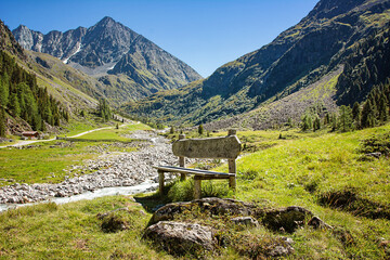 Bench for a break in the mountains with inscription: Keep nature clean.