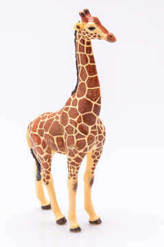 close up of a giraffe made from plastic isolated on a white background
