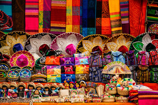Brightly colored generic mexican souvenirs stacked at the local market stall at Chichen-Itza archaeological site.