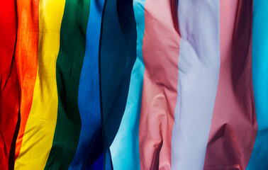 Photo sur Toile Inde gay and transgender pride flags waving on the sky