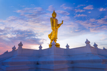 Buddha image or Buddha statue; Standing Buddha image with sunlight ray at Nong Pai Lom temple.