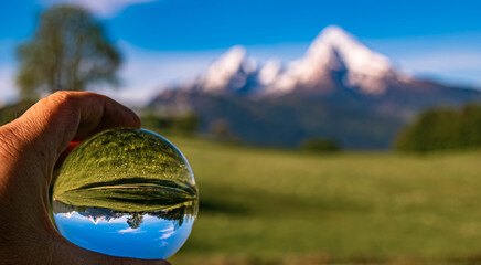 Crystal ball alpine landscape with the famous Watzmann summit near Berchtesgaden, Bavaria, Germany