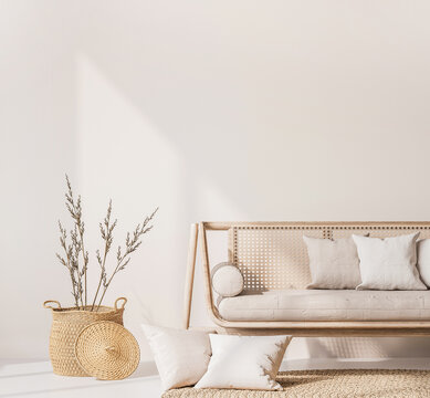 Close up for modern living room interior with natural wooden furniture, rattan basket and trendy carpet. Scandinavian style