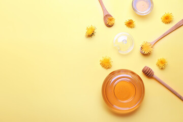 Jar of dandelion honey on color background