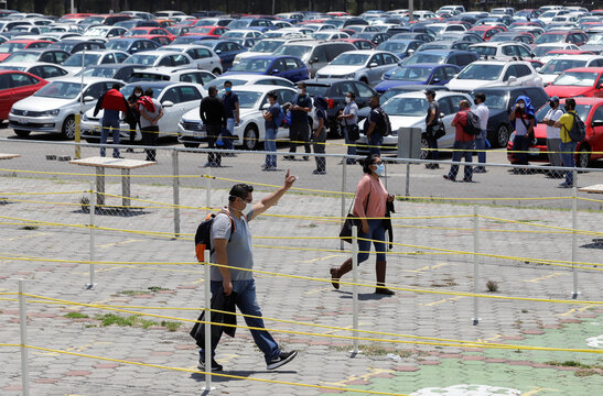 Volkswagen employees arrive to the plant to attend a training before the reopening of the automotive sector as the spread of the coronavirus disease (COVID-19) continues, in Puebla