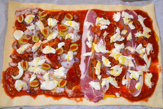 Italian style ready for oven baking make your own pizza with store bought dough and tomato sauce Seafood green olives mozarella cheese Spanish chorizo sun dried tomatoes smoked dry cured bacon rashers