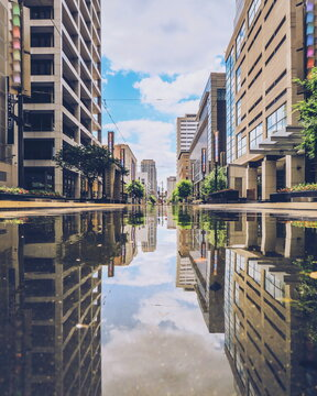 Water reflection of Main Street in Houston downtown, Texas, United States