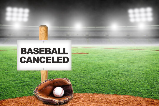 Baseball Canceled Sign on Bat with Glove and Ball in Empty Stadium