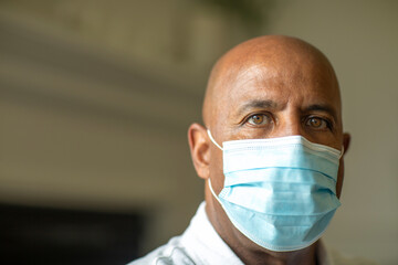Close up view of an African American man wearing a face mask